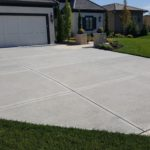 The tear out and replacement services from Aesthetic Concrete Designs has the equipment to give you a beautiful new custom concrete driveway.