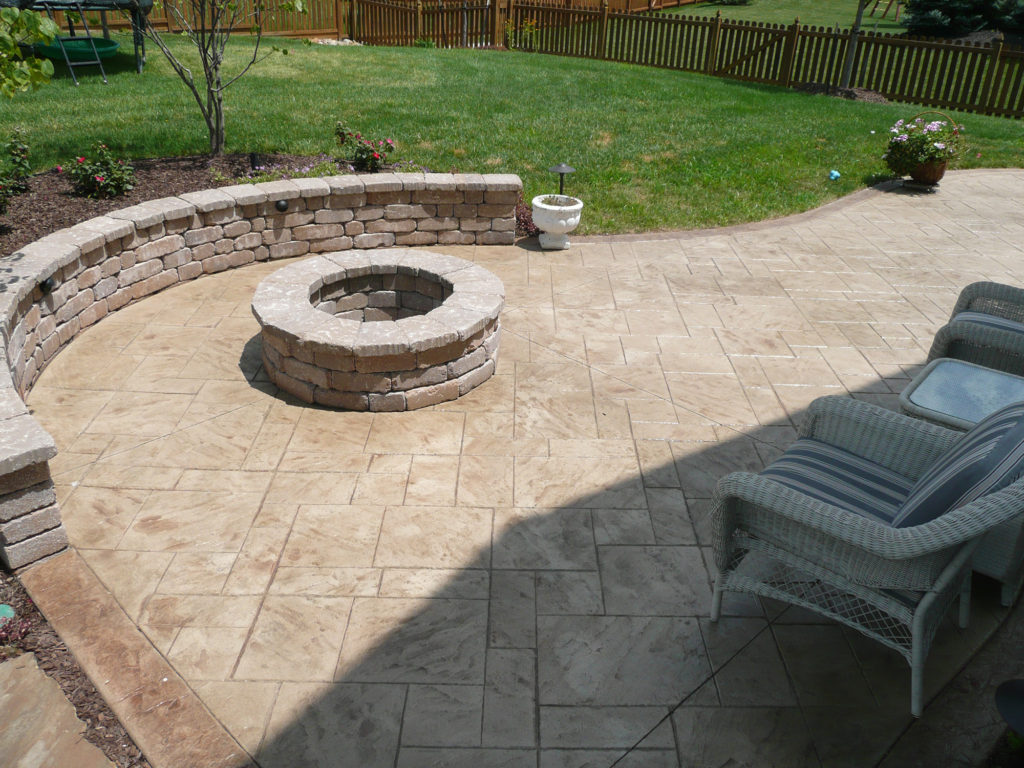 Stamped Concrete with Firepit and Seat Wall