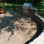 Get a stamped concrete seatwall and a built-in grill with stamped concrete from Aesthetic Concrete Designs.