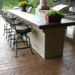 Build a functional and beautiful outdoor living area with concrete patio designs from Aesthetic Concrete Designs.