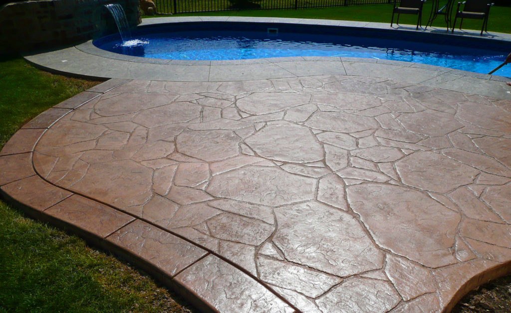 Aesthetic Concrete Designs creates custom concrete pool decks with stamped concrete.