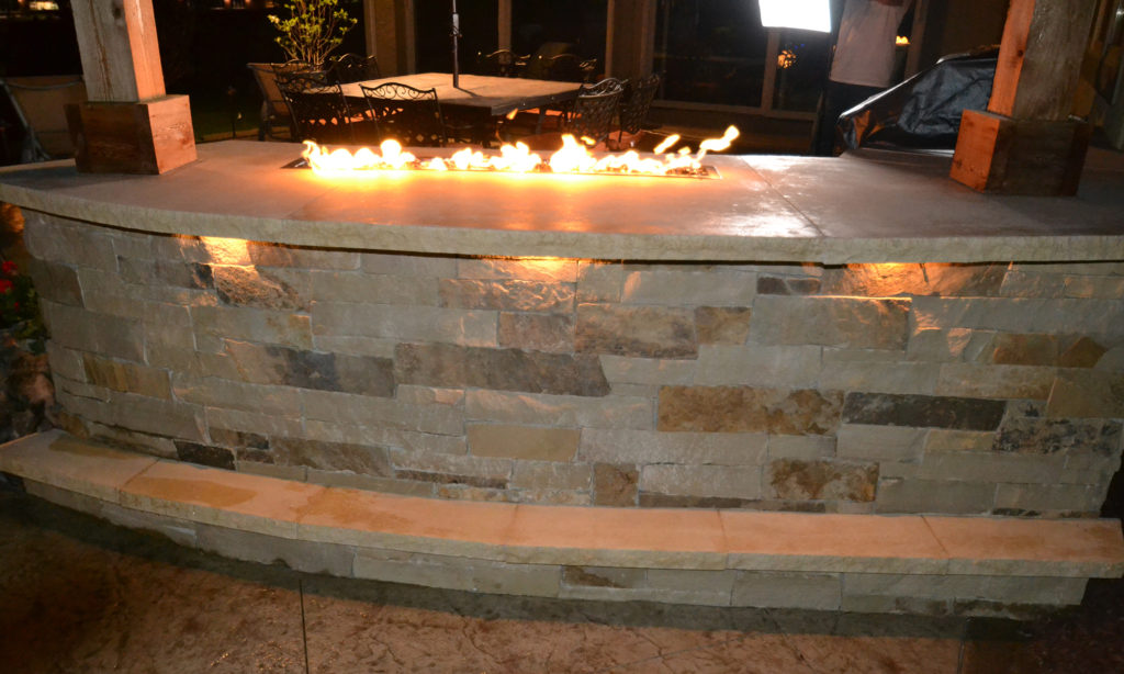 Custom Firepit with Stamped Concrete Patio