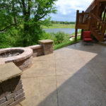 Beautify your patio with a custom fire pit and stamped concrete patio from Aesthetic Concrete Designs.