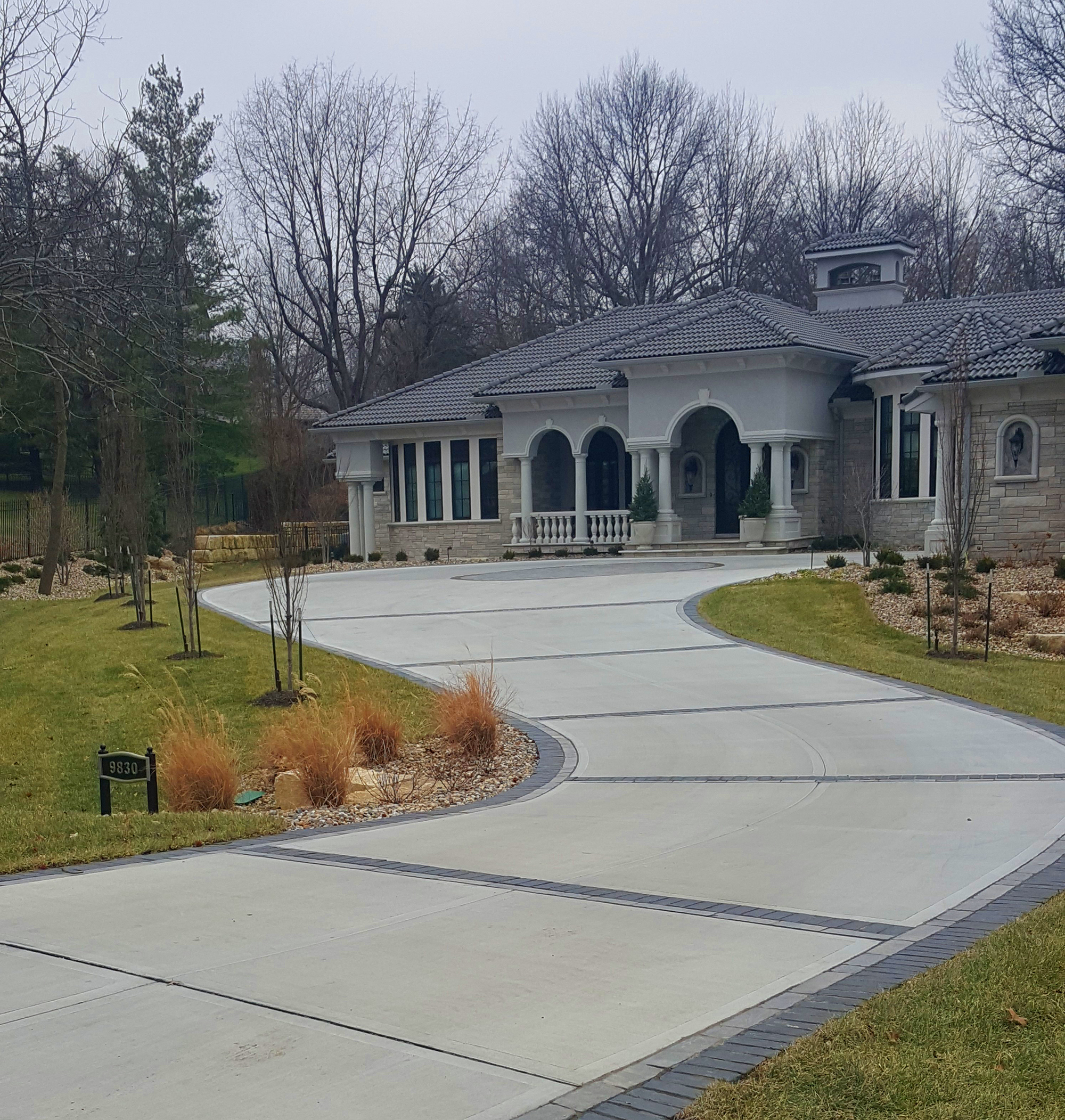 Get a custom concrete driveway from Aesthetic Concrete Designs.