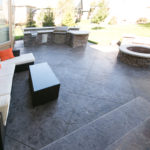 Custom outdoor kitchens, fire pits, and stamped concrete patio from Aesthetic Concrete Designs.