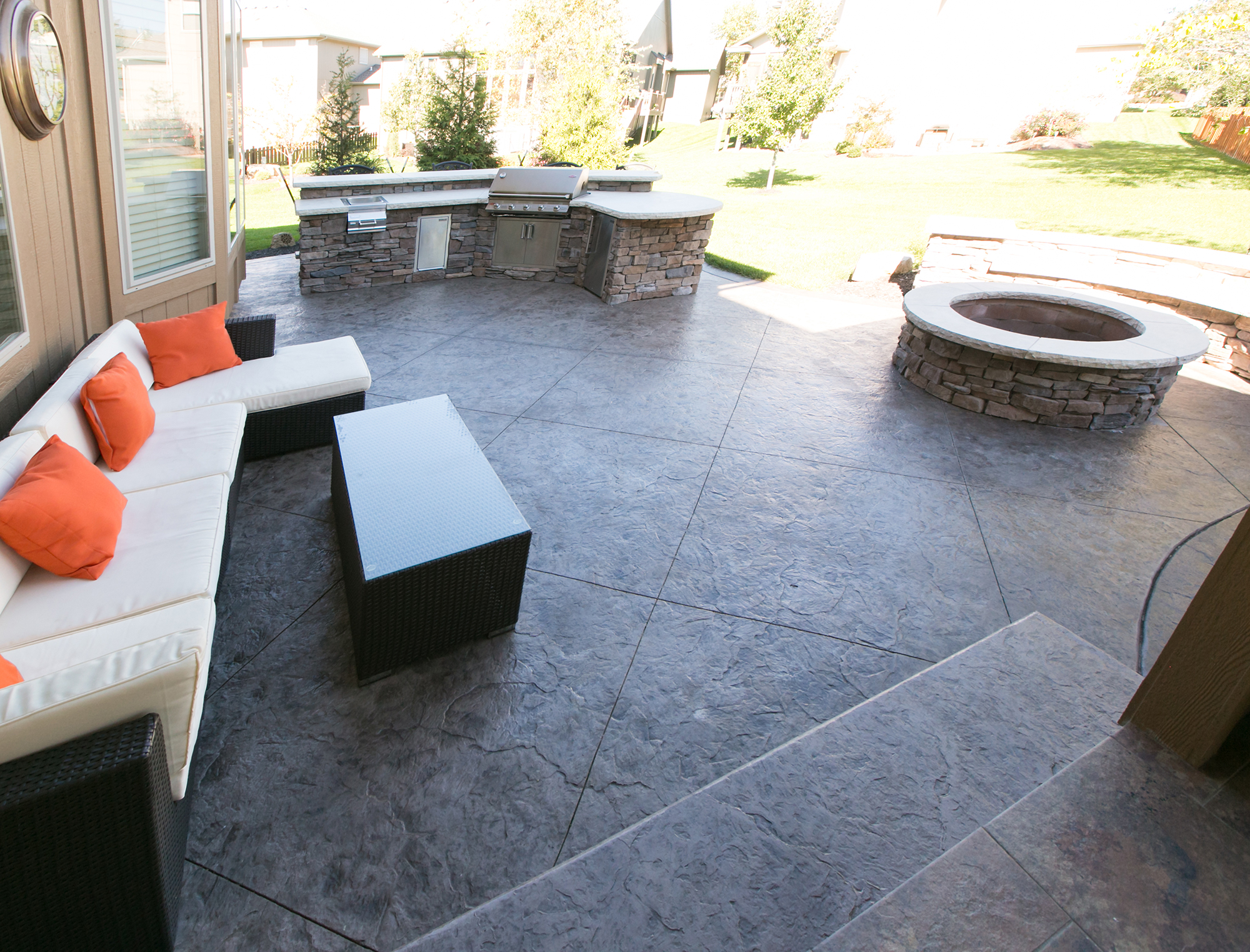 Stamped Concrete Patio with Firepit and Grill