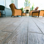 This custom stamped patio from Aesthetic Concrete Designs creates the look of wood planks.