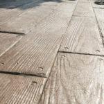 Aesthetic Concrete Designs can create a custom stamped concrete patio with a plank design.