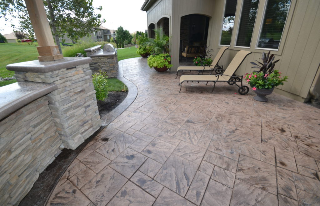 Stamped Concrete Patio with Girll and Seat Wall Idea