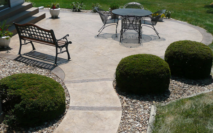 Custom stamped concrete walkways and patios from Aesthetic Concrete Designs.