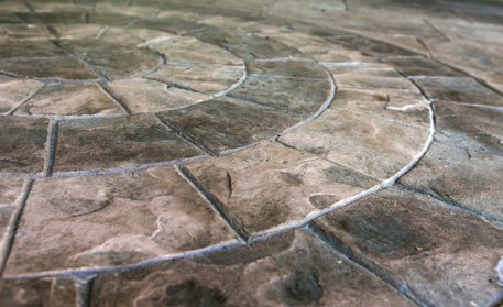 Create a custom patio with stamped concrete designs from Aesthetic Concrete Designs.