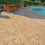Rejuvenate your pool deck with custom formed stamped concrete and color.