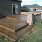 Aesthetic Concrete Designs create a new space for you with Stamped Concrete, Seatwall and Border with Concrete Tops