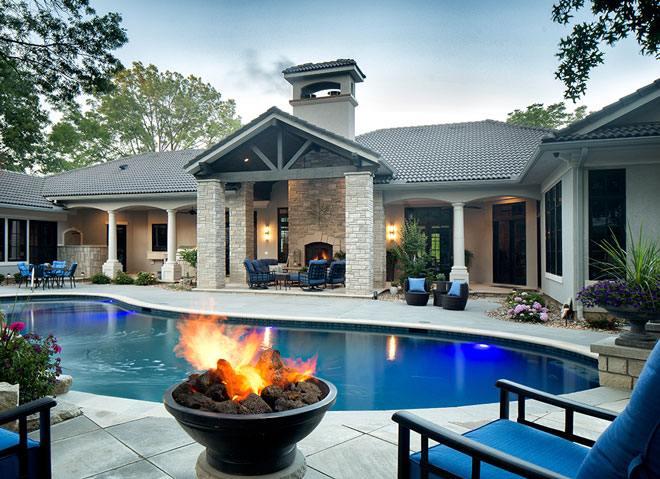 Custom outdoor living area with Lanai, water fall, and pool deck.