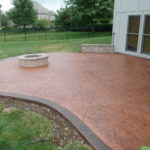 Stamped Concrete Patio with custom integral color and border.