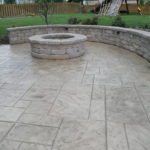 Fire pit and Seat wall on Patterned Stamp Patio.