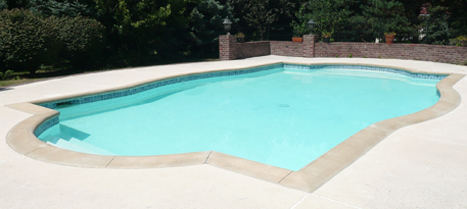 Concrete pool deck installation and concrete coping in Kansas City.